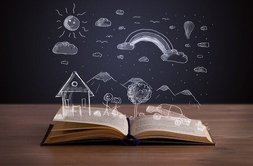 Open book with hand drawn landscape on wooden deck